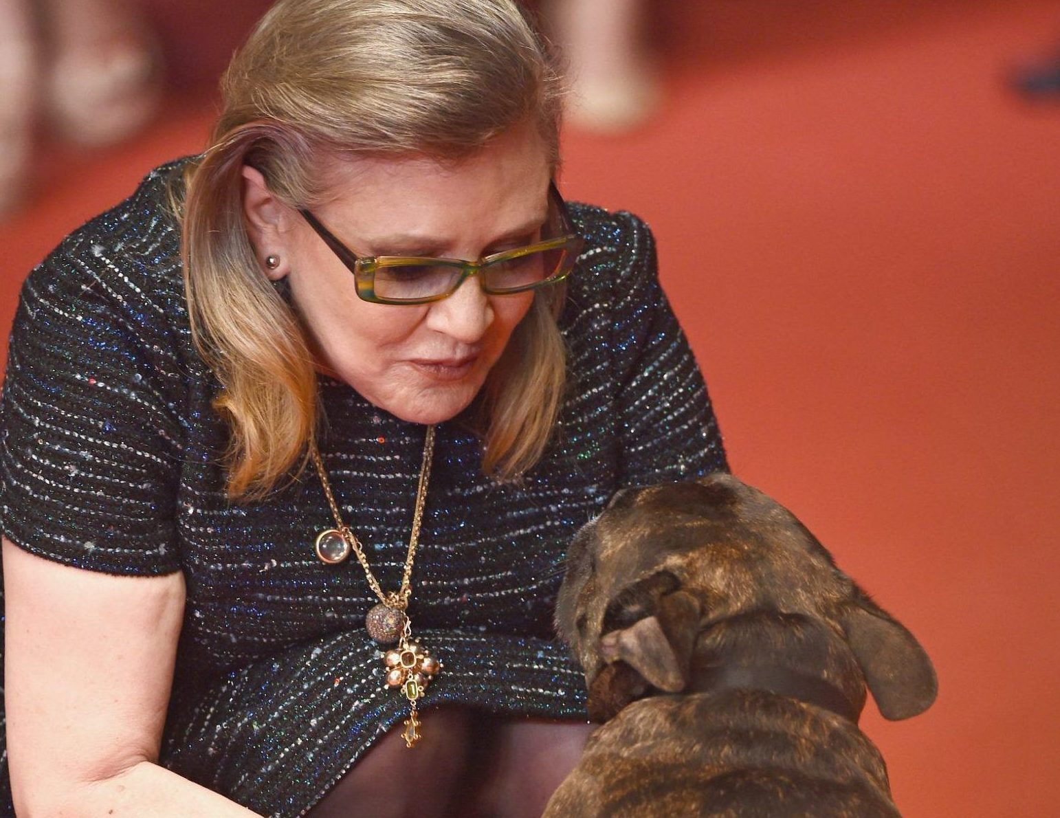 "CANNES, FRANCE - MAY 14: Carrie Fisher and her dog Gary attend ""The Handmaiden (Mademoiselle)"" premiere during the 69th annual Cannes Film Festival at the Palais des Festivals on May 14, 2016 in Cannes, France. (Photo by Ian Gavan/Getty Images)"