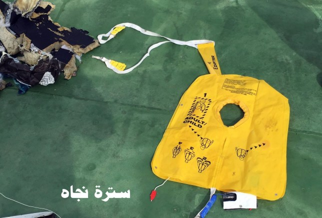 epa05320977 A handout picture made available by the Egyptian Defence Ministry showing a life jacket from the EgyptAir MS804 flight missing at sea, unspecified location in Egypt, 21 May 2016. The Armed Forces of Egypt announced that the debris of an EgyptAir Airbus A320, which had disappeared early on 19 May 2016, as well as personal belongings of the passengers are floating in the Mediterranean Sea, north of the Egyptian city of Alexandria. The EgyptAir passenger jet had left Paris bound for Cairo with 66 people on board, but crashed into the Mediterranean Sea for unknown reasons. EPA/EGYPTIAN DEFENCE MINISTRY / HANDOUT HANDOUT EDITORIAL USE ONLY/NO SALES
