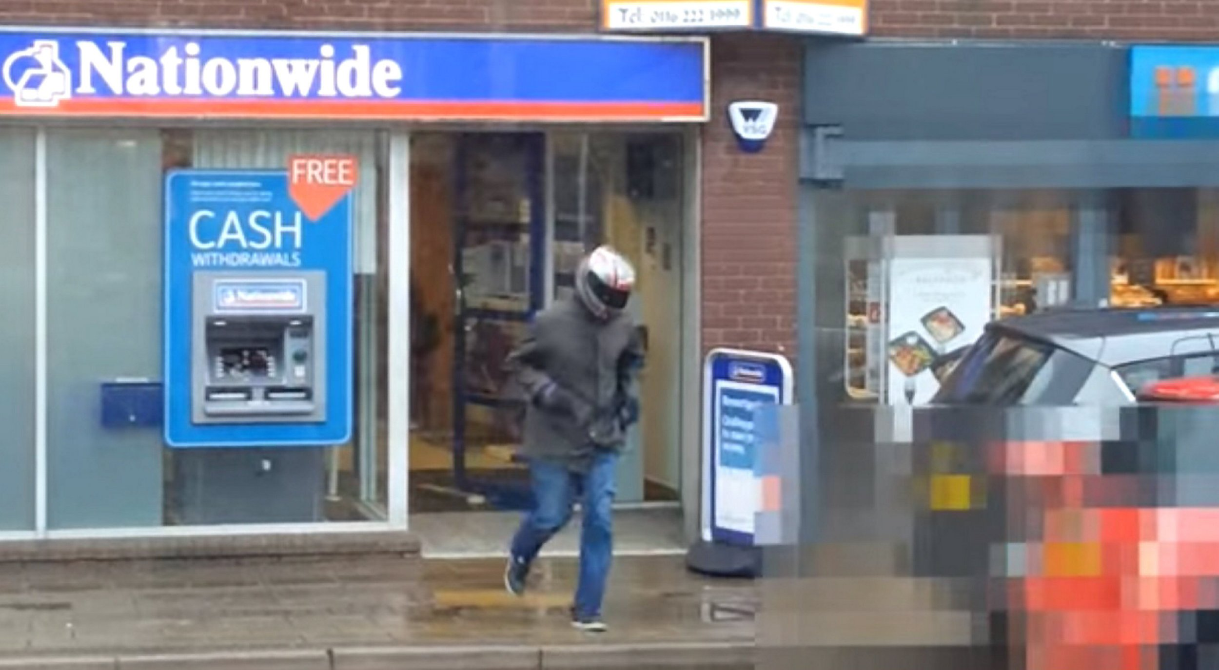A quick-thinking member of the public captured footage on his mobile ëphone of two robbers making off from the scene of an attempted robbery of a Nationwide Bank in Wigston. See Newsteam story NTIRAID; This is the shocking moment an onlooker filmed two armed robbers fleeing from a building society, just seconds after threatening staff with a knife. The quick-thinking bystander captured the footage on his phone, as the criminals ran out of a branch of Nationwide in Wigston, Leics. The men, who were wearing wearing motorcycle helmets, raided the building society at 11.15am on Wednesday last week (11/5). Just moments before, the pair had pulled a knife on terrified staff, ordering them to hand over cash.
