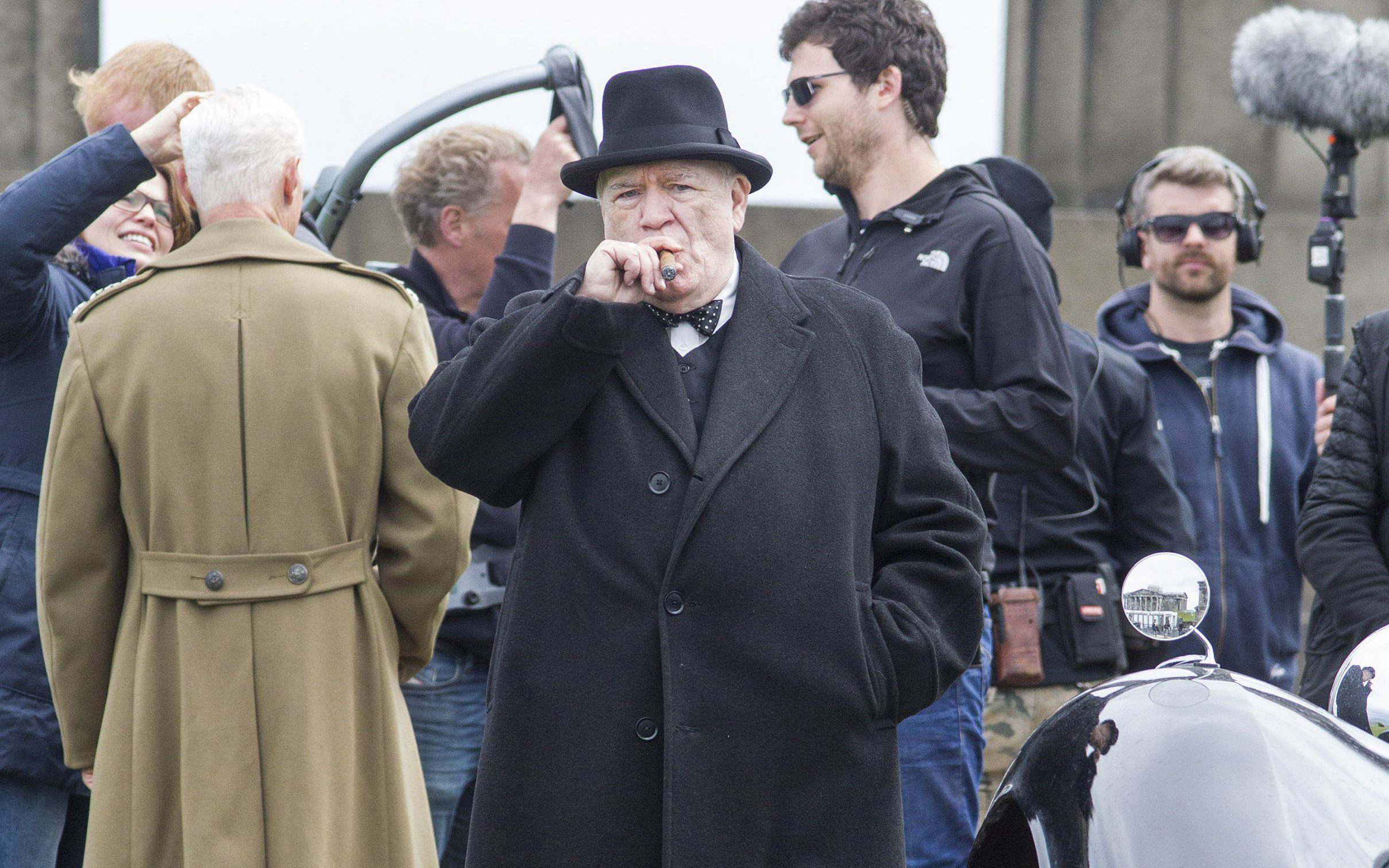 Cigar in hand, Brian Cox films scenes as Winston Churchill in first set pictures