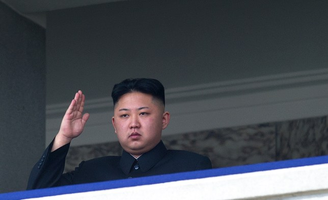 "TO GO WITH Oly-2012-PRK,FEATURE (FILES) This file photo taken on April 15, 2012 shows North Korean leader Kim Jong-Un saluting as he watches a military parade to mark 100 years since the birth of the country's founder and his grandfather, Kim Il-Sung, in Pyongyang. He lacks the toned physique of an Olympian but ""dear respected"" leader Kim Jong-Un will be the inspiration when North Korea's athletes go for gold at the London Olympics.  North Korea are aiming for a record number of medals in London in what would be a timely boost for Kim, the new face of the country's ruling dynasty and its all-pervasive personality cult.      AFP PHOTO / FILES / Ed Jones        (Photo credit should read Ed Jones/AFP/GettyImages)"