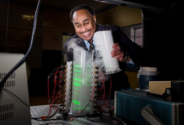 Theoretical physicist Ronald Mallett pours dry ice into a ring laser Photographer: Scott Eisen/Bloomberg via Getty Images