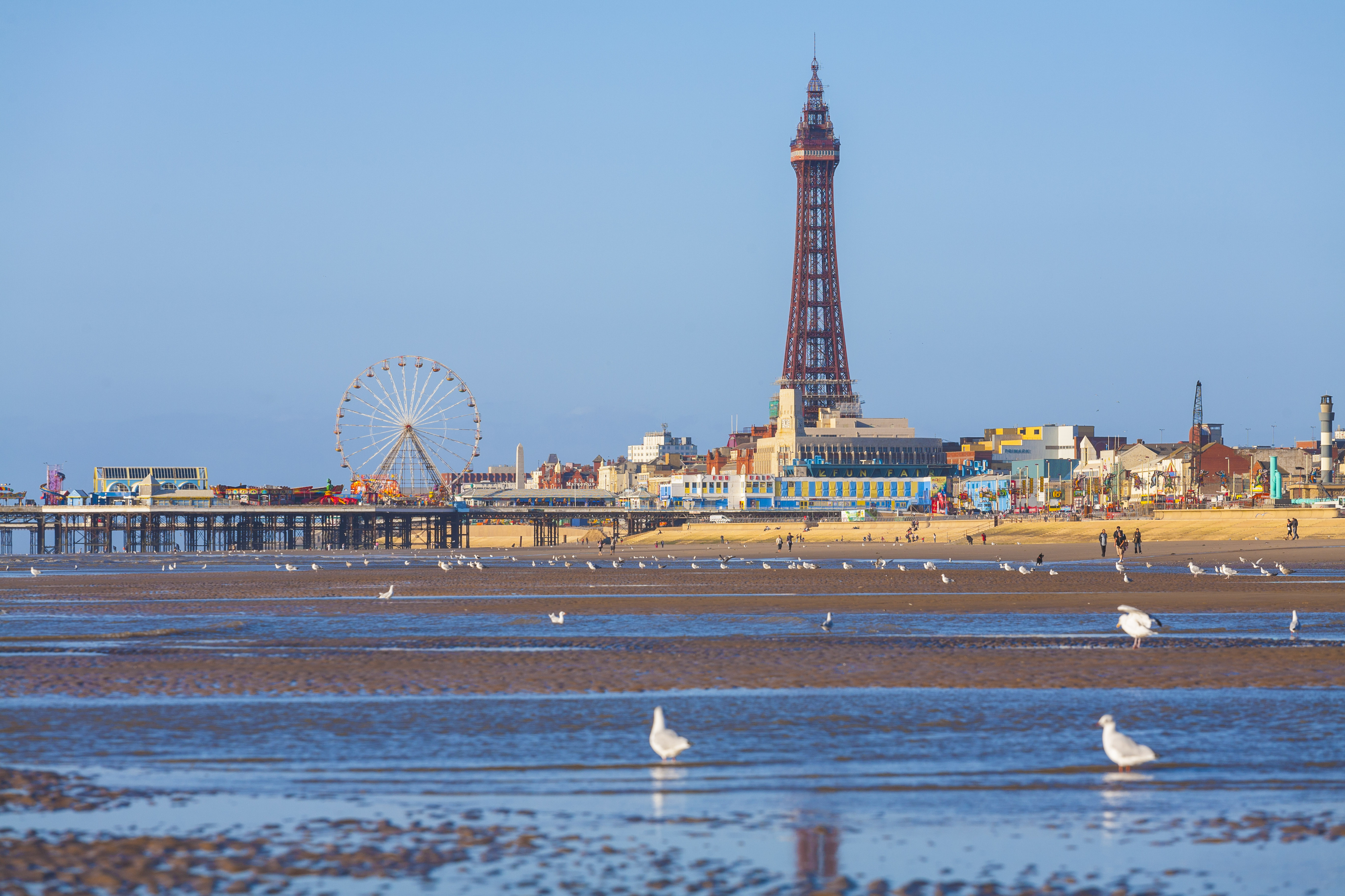 BLACKPOOL, LANCASHIRE, NORTH WEST OF ENGLAND, UNITED KINGDOM - 2009/09/09: Blackpool Beach at Low Tide with Blackpool Tower in the background. (Photo by Pawel Libera/LightRocket via Getty Images)