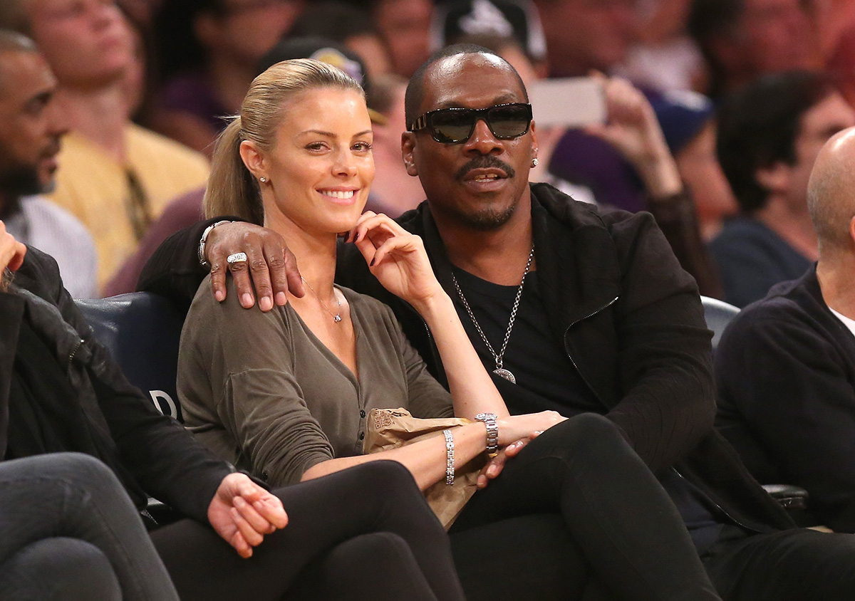 LOS ANGELES, CA - APRIL 12: Eddie Murphy and girlfriend Paige Butcher attend the game between the Dallas Mavericks and the Los Angeles Lakers at Staples Center on April 12, 2015 in Los Angeles, California. The Mavericks won 120-106. NOTE TO USER: User expressly acknowledges and agrees that, by downloading and or using this photograph, User is consenting to the terms and conditions of the Getty Images License Agreement. (Photo by Stephen Dunn/Getty Images)