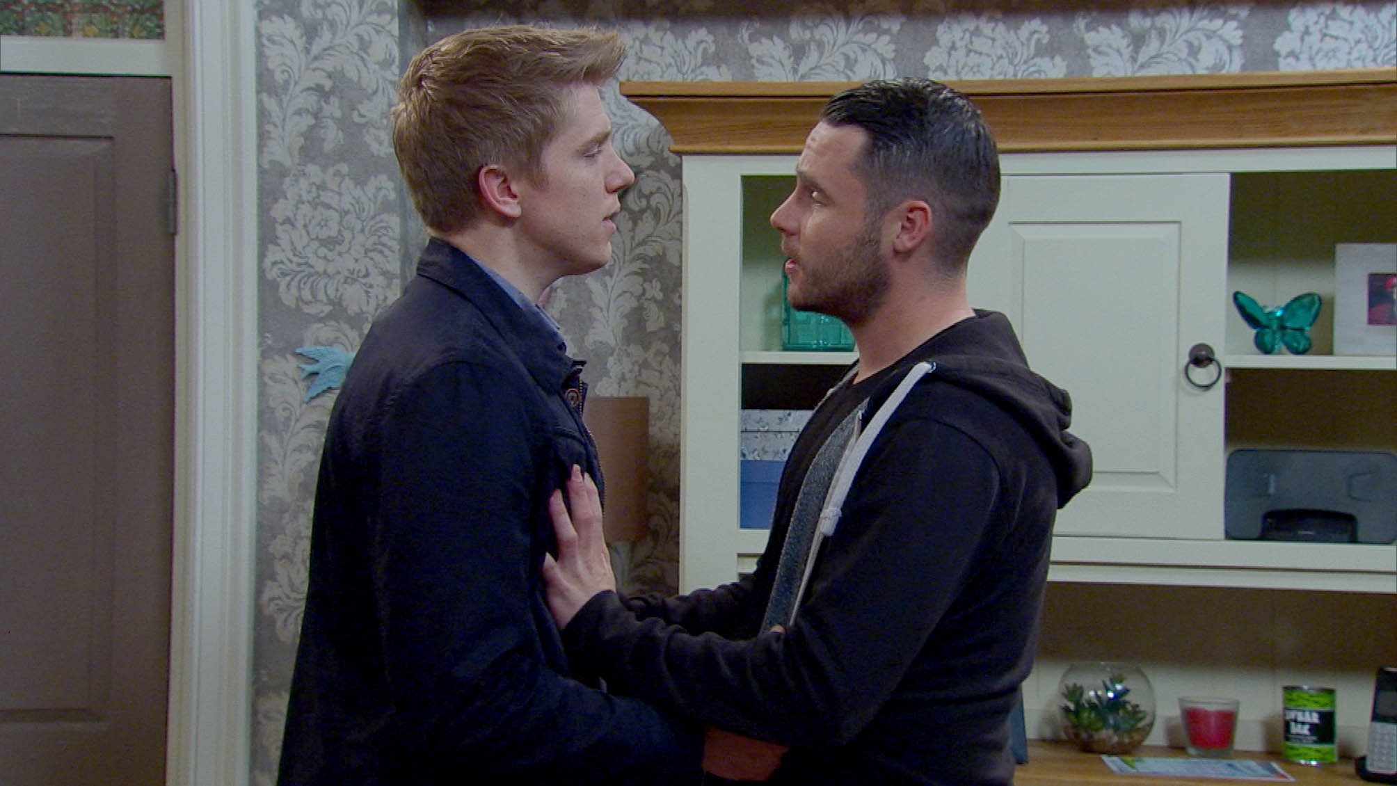 FROM ITV STRICT EMBARGO - No Use Before Tuesday 5 July 2016 Emmerdale - Ep 7555 Thursday 14 July 2016 - 1st Ep Aaron Dingle's [DANNY MILLER] embarrassed when Charity walks in on him and Robert Sugden [RYAN HAWLEY] in the shower. Aaron starts to broach the subject of moving in together to Robert but they're interrupted again, this time by a police officer who says there's new evidence showing Robert bribed Ryan... Picture contact: david.crook@itv.com on 0161 952 6214 Photographer - Andrew BOyce This photograph is (C) ITV Plc and can only be reproduced for editorial purposes directly in connection with the programme or event mentioned above, or ITV plc. Once made available by ITV plc Picture Desk, this photograph can be reproduced once only up until the transmission [TX] date and no reproduction fee will be charged. Any subsequent usage may incur a fee. This photograph must not be manipulated [excluding basic cropping] in a manner which alters the visual appearance of the person photographed deemed detrimental or inappropriate by ITV plc Picture Desk. This photograph must not be syndicated to any other company, publication or website, or permanently archived, without the express written permission of ITV Plc Picture Desk. Full Terms and conditions are available on the website www.itvpictures.com