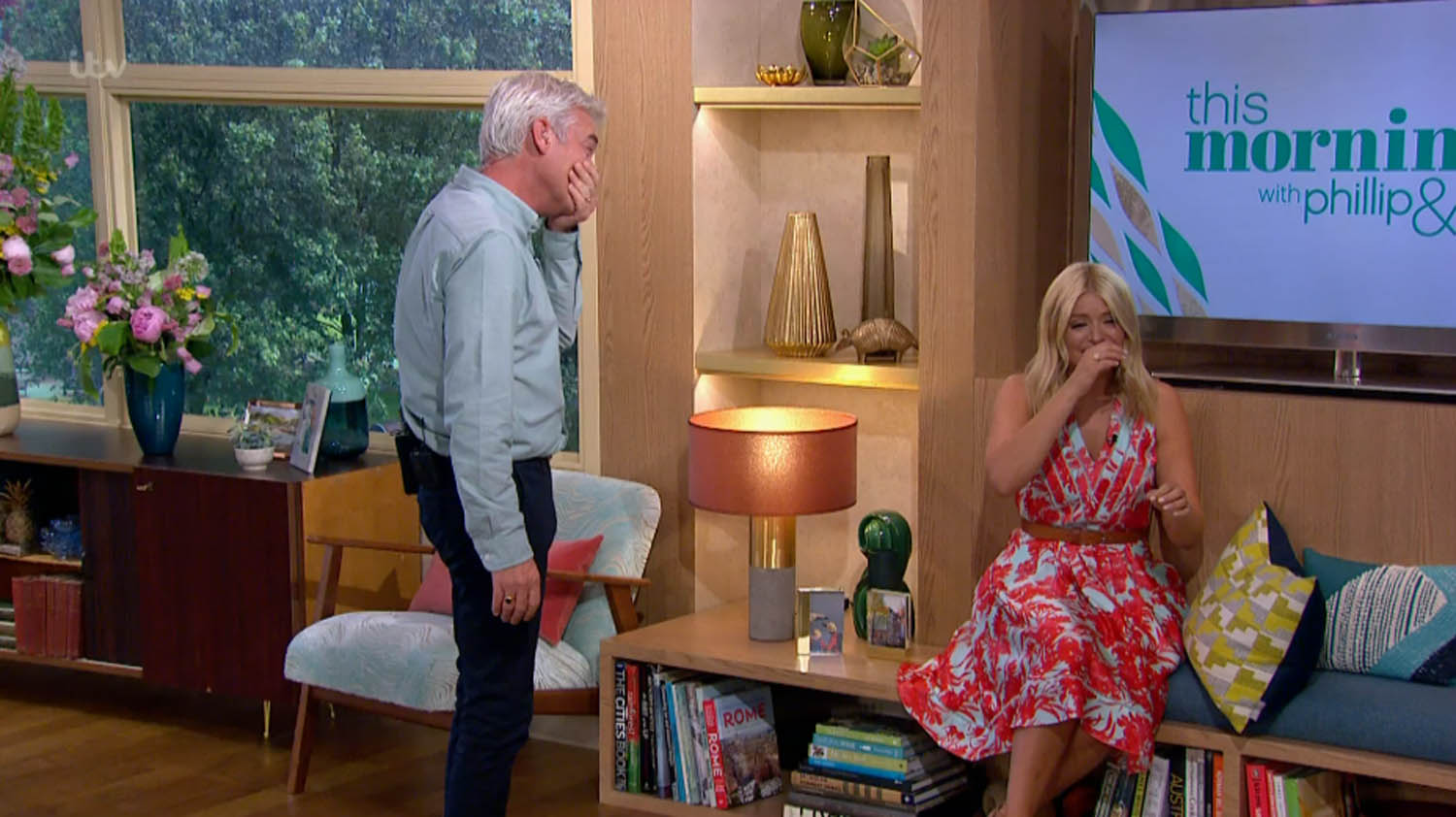 """****Ruckas Videograbs**** (01322) 861777 *IMPORTANT* Please credit ITV for this picture. 08/06/16 This Morning - ITV1 Grabs from this morning's show which saw presenter's Holly Willoughby and Phillip Schofield having a huge giggling fit - so much so that they both were crying tears of laughter and couldn't compose themselves to read the links off of the autocue. It appeared they got the giggles after Phiilip read out a link which said a woman """"developed a close bond"""" with an elephant who saved her life in the 2004 Tsunami. Neither could reain any composure and Holly ended up having to sit down as tears rolled down her eyes. The pair have had giggling fits in the past but Phillip said """"This is the worst it's happened for ages. We haven't done this for a long time."""" Office (UK) : 01322 861777 Mobile (UK) : 07742 164 106 **IMPORTANT - PLEASE READ** The video grabs supplied by Ruckas Pictures always remain the copyright of the programme makers, we provide a service to purely capture and supply the images to the client, securing the copyright of the images will always remain the responsibility of the publisher at all times. Standard terms, conditions & minimum fees apply to our videograbs unless varied by agreement prior to publication."""