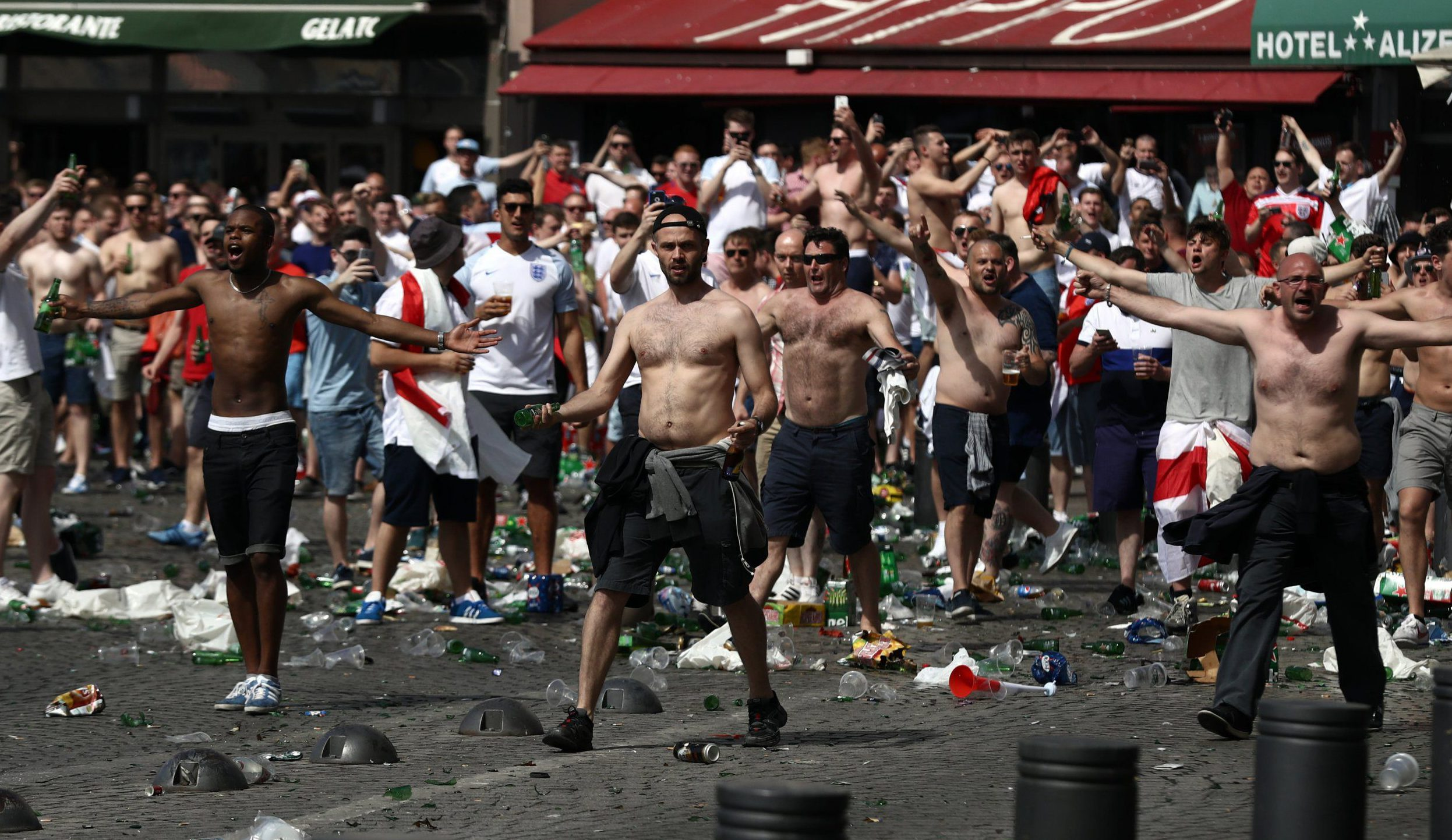 MARSEILLE, FRANCE - JUNE 11: England fans throw bottles and clash with police ahead of the game against Russia later today on June 11, 2016 in Marseille, France. Football fans from around Europe have descended on France for the UEFA Euro 2016 football tournament. (Photo by Carl Court/Getty Images)