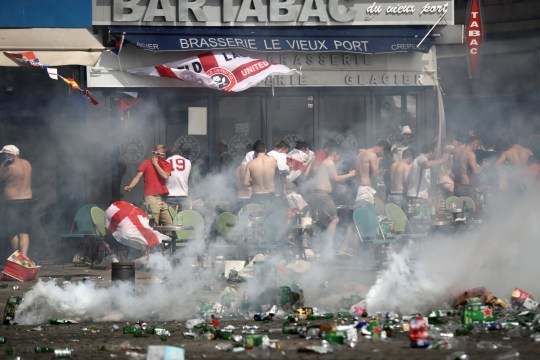 MARSEILLE, FRANCE - JUNE 11: England fans react after police sprayed tear gas during clashes ahead of the game against Russia later today on June 11, 2016 in Marseille, France. Football fans from around Europe have descended on France for the UEFA Euro 2016 football tournament. (Photo by Carl Court/Getty Images)