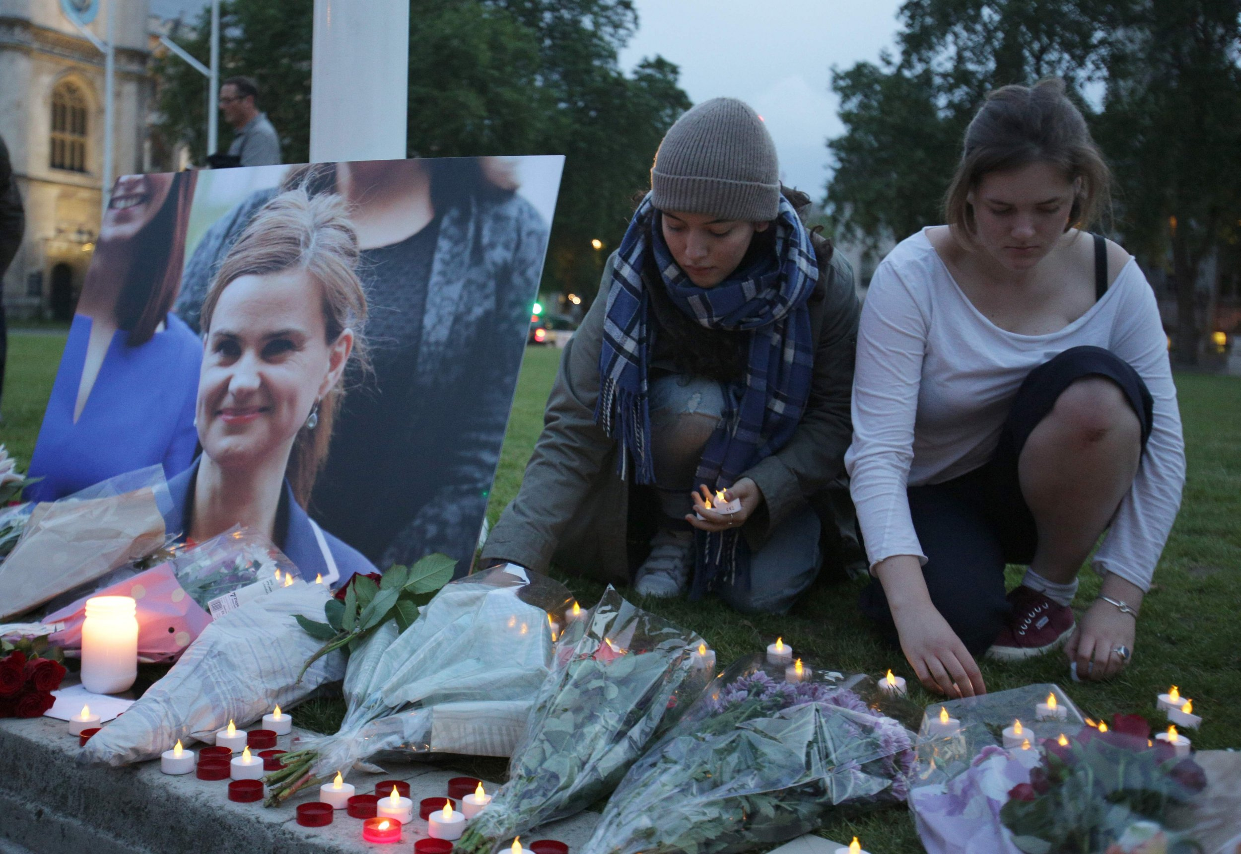 Floral tributes and candles are placed by a picture of slain Labour MP Jo Cox at a vigil in Parliament square in London on June 16, 2016. Cox died today after a shock daylight street attack, throwing campaigning for the referendum on Britain's membership of the European Union into disarray just a week before the crucial vote. / AFP PHOTO / DANIEL LEAL-OLIVASDANIEL LEAL-OLIVAS/AFP/Getty Images