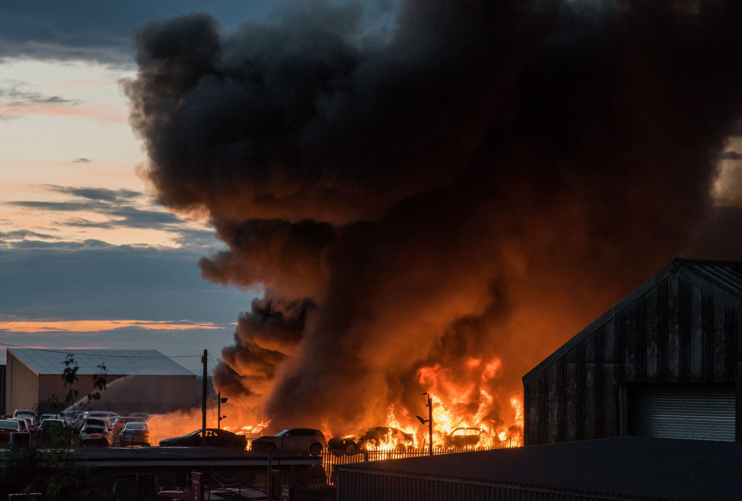 Firefighters battle huge blaze at a scrapyard involving 179 cars