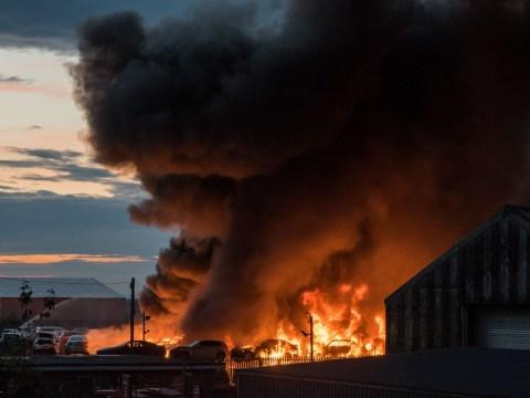 Firefighters battle huge blaze at a scrapyard involving 179 cars