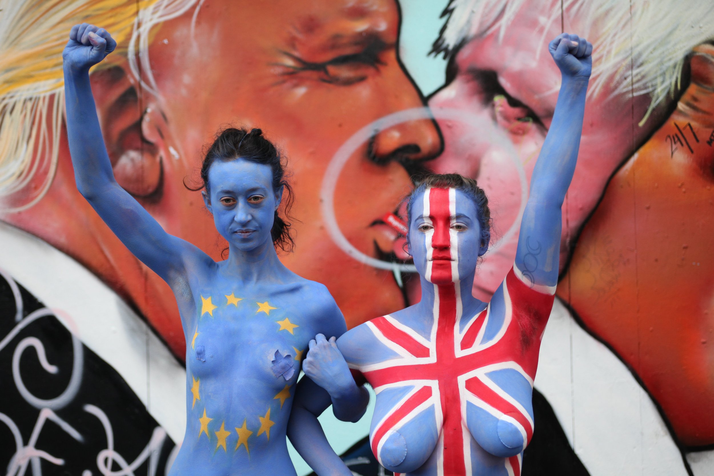 "Sibi Moore(EU) and Claire Green(Union Jack) Strip down to raise awarness for remain in the UE campaign. Bristol, britain. June 19 2016. See SWNS story SWNAKED; Two 'Remain' campaigners walked around a busy city centre yesterday (Sun) while completely NAKED in a bid to ""strip down the argument for Brexit"". Sibi Moore and Claire Green staged the protest to ""expose the effects"" leaving the EU would have on future generations in a last ditch attempt to persuade vote to stay. The pair set off from Stokes Croft, Bristol, at around 2.30pm and walked to the bustling Harbourside - Sibi painted as a Union Jack and Claire decorated as an EU flag. They handed out leaflets as they made their way through the city with nothing but lashings of blue body paint and skimpy knickers to protect their dignity. Sibi, 20, said: ""One of the reasons we wanted to do this is because there has been a lot of focus on the various political parties and what they are saying."