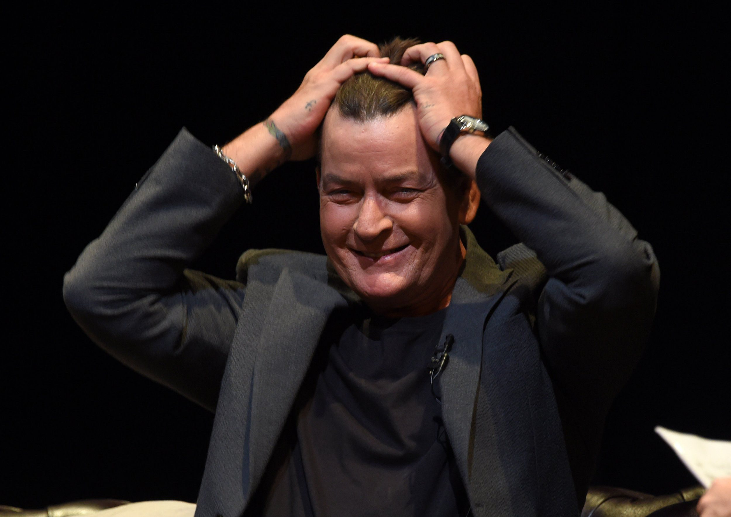 Charlie Sheen offers to buy Rihanna a drink after calling her a 'b***h'