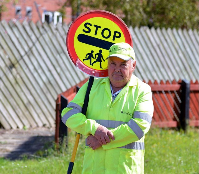 PIC FROM CATERS NEWS - (PICTURED: Bridlington Lollipop Man Colin Thompson has been suspended from his job for making inappropriate comments.) - Hundreds of outraged parents have launched a campaign to reinstate a popular lollipop man who was suspended after paying a mum and daughter a COMPLIMENT while on duty. Lollipop man Colin Thompson, 71, made what he deemed to be a complimentary remark to a mother and daughter at his Bridlington crossing. But another parent walking behind the pair overheard him and lodged a complaint about his inappropriate comment, leading to his suspension by East Riding Council. Granddad Colin, who has been the lollipop man at Burlington Junior and Burlington Infant schools for four years, now faces a council investigation. SEE CATERS COPY.