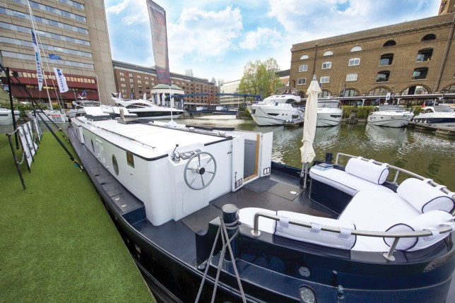 A supercar dealer fed up with Londonís property prices has swapped mortar for water by building a luxury houseboat for £300,000. See SWNS story SWBOAT. Alex Prindivilleís two bedroom floating home boasts a log burning stove, granite worktop and power shower. But instead of having to pay more than £1 million for a similarly-sized flat on St Katherine Docks in East London he paid less than one third of the price. The businessman found a master boat-builder in Sheffield who hand-made a steel boat with the space and finish to turn his dream into reality. It was then fitted with pressure-jet central heating with ësmart controlí, full electrics, hot and cold running water, dish washer, washing machine, solid wood flooring and a skylight.