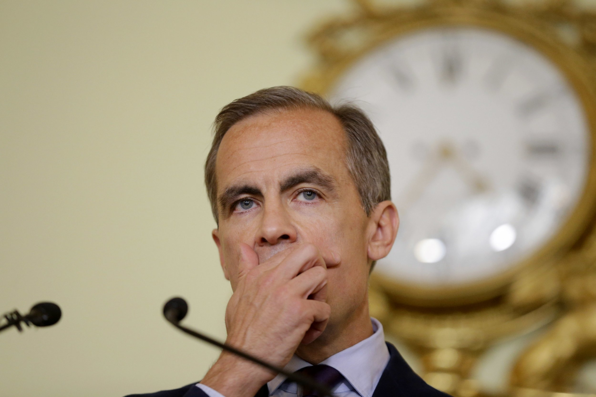 The governor of the Bank of England Mark Carney listens to a question during a press conference, his first since the leave result of the European Union referendum, at the Bank of England in the City of London, Thursday, June 30, 2016. Carney says the uncertainty over Britain's exit from the European Union means the central bank will likely have to provide monetary stimulus this summer. (AP Photo/Matt Dunham, Pool)