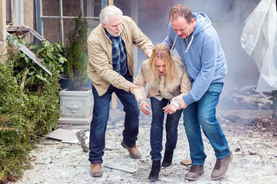 FROM ITV STRICT EMBARGO - No Use Before Sunday 26 June 2016 Emmerdale Tuesday 28 July 2016 This is the dramatic moment that Dan (Liam Fox) and Ronnie (John McArdle) escape the burning building having rescued Nicola (Nicola Wheeler) who was trapped and screaming for help. Dan and Ronnie had witnessed the explosion and run into the flames after hearing Nicola's cries. They are all unaware that desperate Rakesh (Pasha Bocarie) has set fire to his development as an insurance job As Dan looks after Nicola, Ronnie, worried for Priya and Vanessa, runs back in. Could all of the villagers escape this deadly fire unscathed? Emmerdale, The Mill fire is an hour long episode that will TX on Tuesday (28th June) Picture contact: david.crook@itv.com on 0161 952 6214 Photographer - Mark Bruce This photograph is (C) ITV Plc and can only be reproduced for editorial purposes directly in connection with the programme or event mentioned above, or ITV plc. Once made available by ITV plc Picture Desk, this photograph can be reproduced once only up until the transmission [TX] date and no reproduction fee will be charged. Any subsequent usage may incur a fee. This photograph must not be manipulated [excluding basic cropping] in a manner which alters the visual appearance of the person photographed deemed detrimental or inappropriate by ITV plc Picture Desk. This photograph must not be syndicated to any other company, publication or website, or permanently archived, without the express written permission of ITV Plc Picture Desk. Full Terms and conditions are available on the website www.itvpictures.com