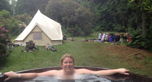 Me in the hot tub with the tent where a lot of interesting shit went down in the background (Picture: Metro.co.uk)