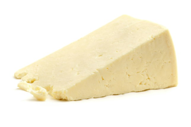 Cheshire Cheese isolated on a white background.