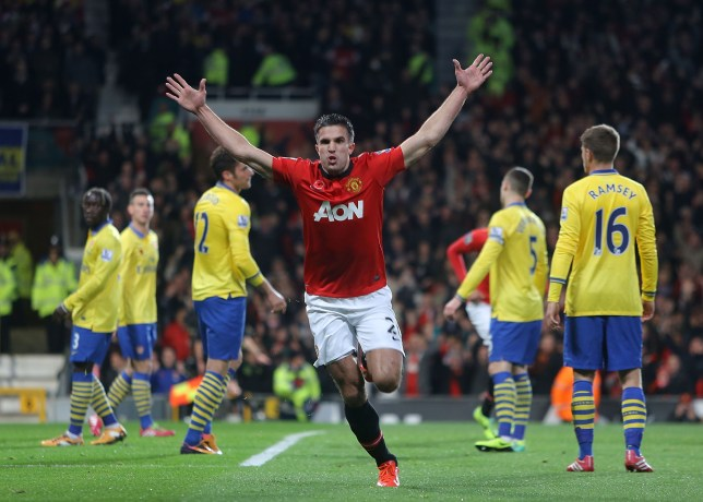 MANCHESTER, ENGLAND - NOVEMBER 10: Robin van Persie of Manchester United celebrates s oring their first goal during the Barclays Premier League Match between Manchester United and Arsenal at Old Trafford on November 10, 2013 in Manchester, England. (Photo by Tom Purslow/Man Utd via Getty Images)