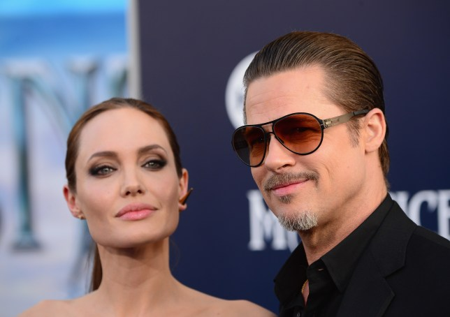 "HOLLYWOOD, CA - MAY 28: Actress Angelina Jolieand Brad Pitt arrive at the World Premiere Of Disney's ""Maleficent"" at the El Capitan Theatre on May 28, 2014 in Hollywood, California. (Photo by Frazer Harrison/Getty Images)"