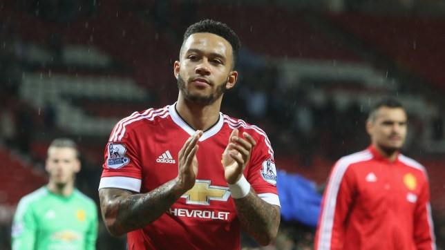 MANCHESTER, ENGLAND - MAY 17: Memphis Depay of Manchester United applauds the fans during a lap of honour following the Barclays Premier League match between Manchester United and AFC Bournemouth at Old Trafford on May 17, 2016 in Manchester, England. (Photo by Tom Purslow/Man Utd via Getty Images)