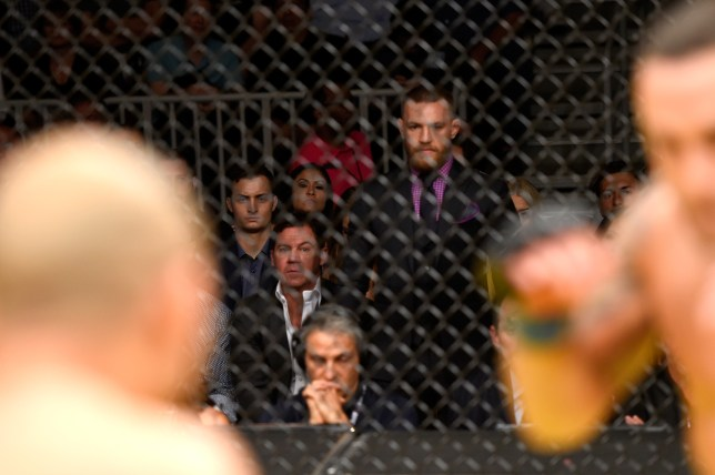 LAS VEGAS, NV - JULY 09: UFC featherweight champion Conor McGregor (center) watches Jose Aldo of Brazil vs Frankie Edgar in their UFC interim featherweight championship bout during the UFC 200 event on July 9, 2016 at T-Mobile Arena in Las Vegas, Nevada. (Photo by Josh Hedges/Zuffa LLC/Zuffa LLC via Getty Images)