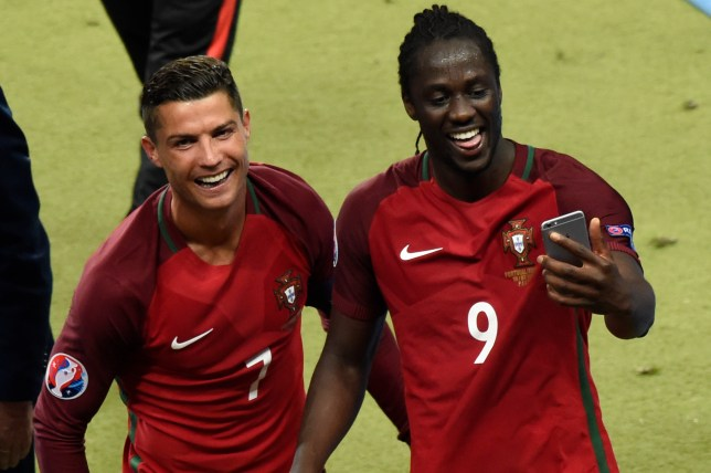 TOPSHOT - Portugal's forward Cristiano Ronaldo (L) and Portugal's forward Eder take a selfie as they arrive to receive their medals after the Euro 2016 final football match between Portugal and France at the Stade de France in Saint-Denis, north of Paris, on July 10, 2016. / AFP / MIGUEL MEDINA (Photo credit should read MIGUEL MEDINA/AFP/Getty Images)