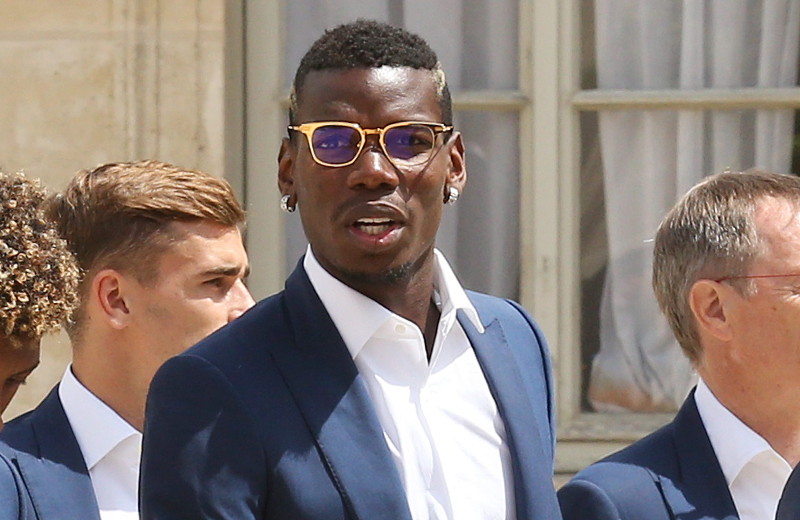 PARIS, FRANCE - JULY 11: Paul Pogba and teammates arrive at Elysee Palace for a lunch with President of France Francois Hollande on July 11, 2016 in Paris, France. (Photo by Jean Catuffe/Getty Images)