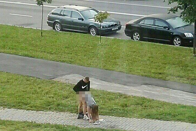 """CEN-Pic shows: couple having sex on the street;nnA couple have been caught having sex in the doggy position in a doggy forum - the middle of the road!nnThe bizarre photo was taken in the city of Minsk in central Belarus.nnThe photo of the fornicating couple was published by a female netizen on her Twitter account.nnAllegedly the couple were making outdoor whoopee in the early hours, and the loud moans of the woman woke up local residents.nnThe released photo has quickly gone viral and became a popular meme.nnNetizen ¿Ihar Losik ¿ said: """"This famous photo from Sukharevo. I wonder what was left out of sight.""""nnIf the couple gets caught both of them will face a heavy fine for hooliganism.nnHowever, the woman, who posted the photo of the pair, might get a fine too.nnIn this case posting such photos online but be see as dissemination of pornography.nnNetizen ¿rzk¿ said: """"Just do it.""""nnAnd ¿NordicRuss¿ added: """"You never know, when love and passion will hit you. Hit you hard."""" Credit: CEN"""