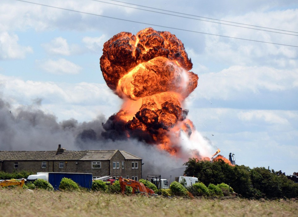 A high fireball rises above Thorn Tree Farm, Northowram, near Halifax, West Yorkshire as fire rages at an industrial compound housing 25 HGV lorries and potentially explosive gases. Police and fire authorities have advised residents in the area to keep windows and doors shut and to remain indoors.