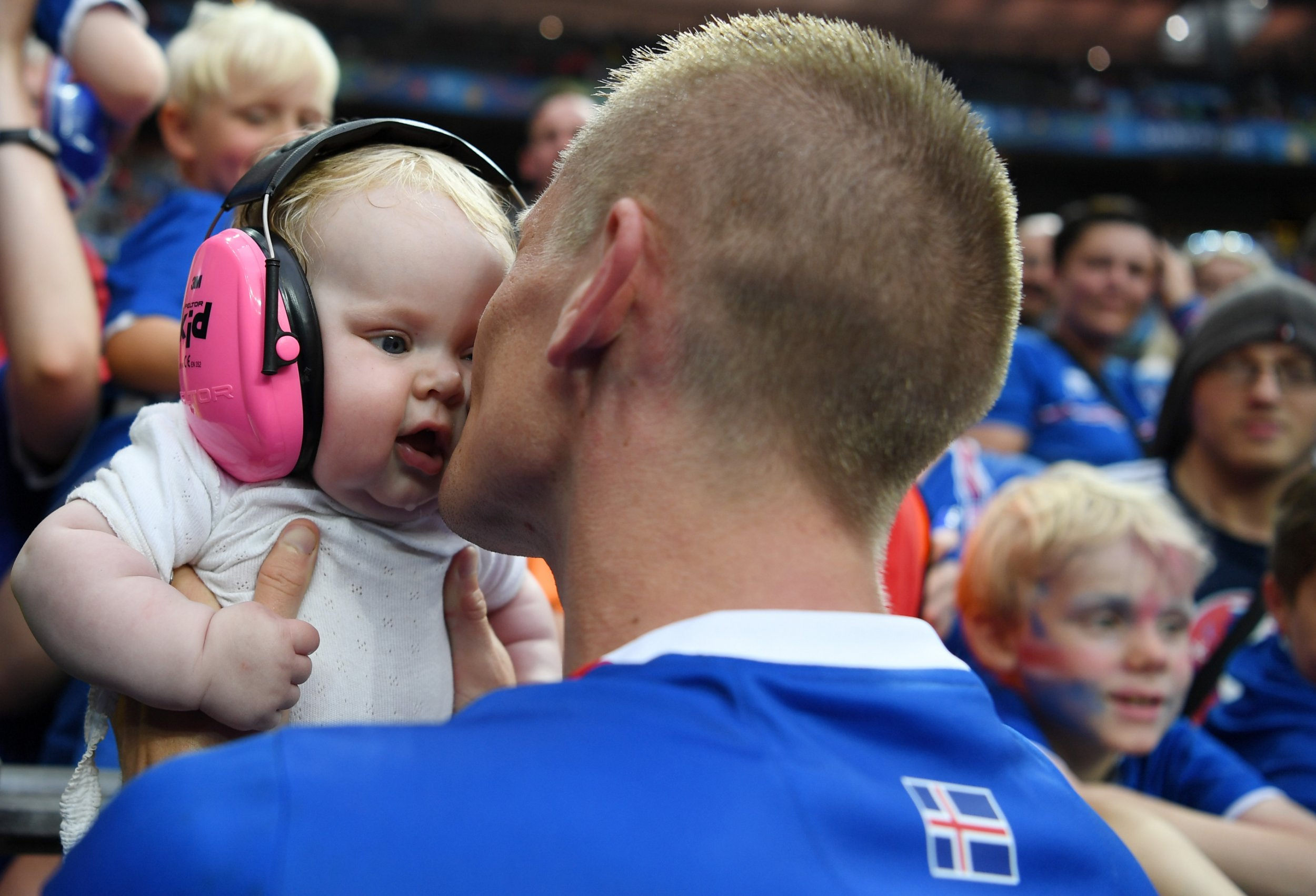 PARIS, FRANCE - JUNE 22: Ari Skulason of Iceland kisses to his child to celebrate his team's 2-1 win with his children after the UEFA EURO 2016 Group F match between Iceland and Austria at Stade de France on June 22, 2016 in Paris, France. (Photo by Shaun Botterill/Getty Images)