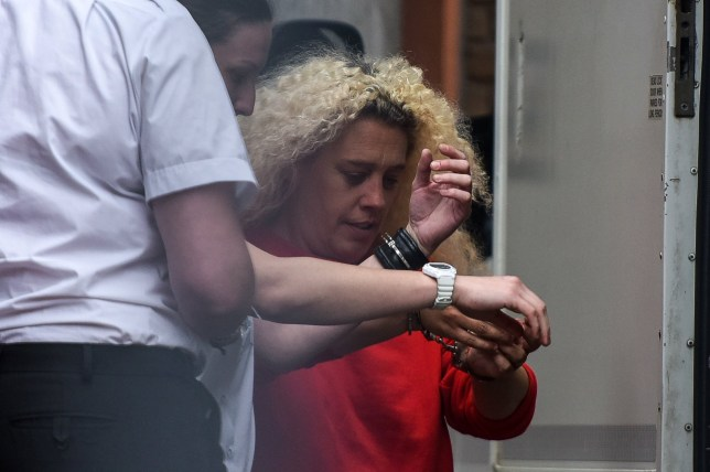 Kelly Martin, 42, is pictured being escorted to a prison van following her appearance at Basildon Magistrates Court, Essex on July 04 2016. See MASONS story MNWEE; Kelly Martin has appeared in court charged with outraging public decency after footage emerged of someone urinating on a war memorial on the 100th anniversary of The Somme. The alleged offence happened on the memorial in Grays, Essex, just hours after the historic centenary had been marked. Kelly Martin, 42, of Grays, is was up before Magistrates at Basildon.