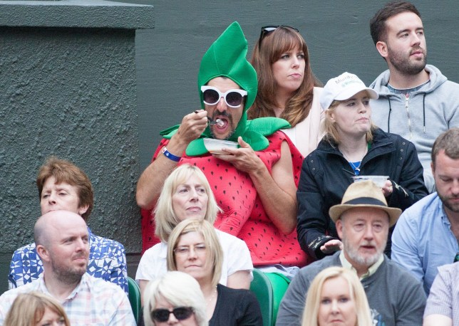 strawberry man at Wimbledon. Editorial use only. No merchandising. For Football images FA and Premier League restrictions apply inc. no internet/mobile usage without FAPL license - for details contact Football Dataco Mandatory Credit: Photo by Mark Greenwood/IPS/REX/Shutterstock (5745062br) A man dressed as a Strawberry sits and eats Strawberries, Wimbledon Championships 2016, Day Eight, All England Lawn Tennis & Croquet Club, Church Rd, London, United Kingdom - 4th July 2016 Wimbledon Championships 2016, Day Eight, All England Lawn Tennis & Croquet Club, Church Rd, London, United Kingdom - 4th July 2016