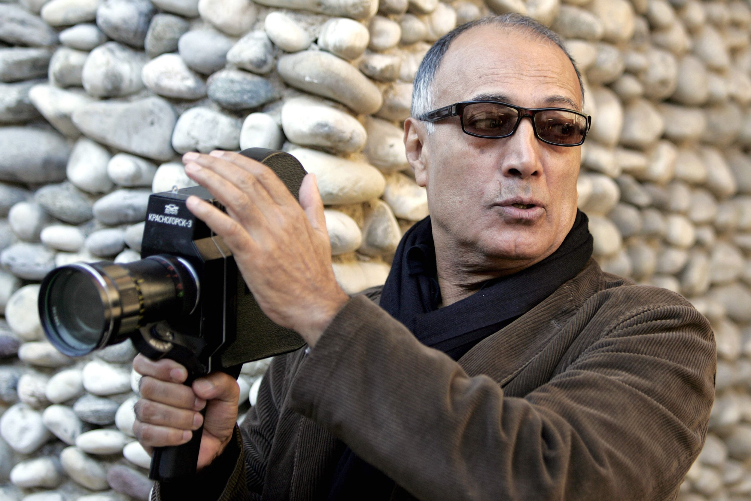 (FILES) This file photo taken on December 4, 2007 shows internationally acclaimed Iranian film maker Abbas Kiarostami giving instructions during a course with students of the Villa Arson art school in Nice. Famed Iranian director Kiarostami died aged 76 in Paris on July 4, 2016, Iranian media reported. / AFP PHOTO / ERIC ESTRADEERIC ESTRADE/AFP/Getty Images