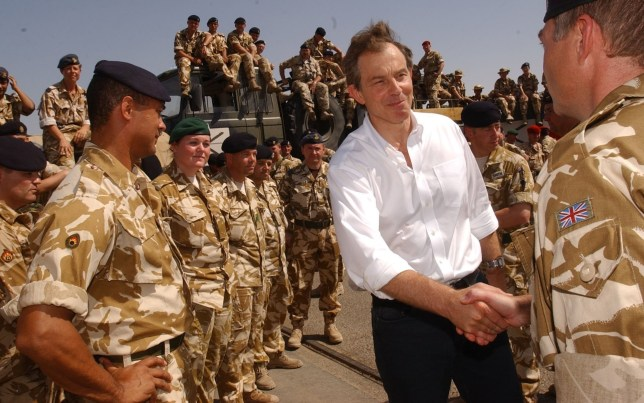 Britain's Prime Minister Tony Blair meets British troops in the port of Umm Qasr southern Iraq, May 29, 2003. Picture taken May 29, 2003. REUTERS/POOL/Stefan Rousseau/File Photo