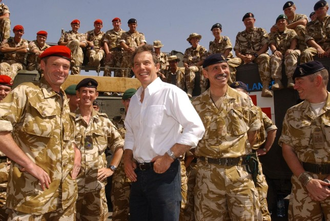File photo dated 29/05/03 of former Prime Minister Tony Blair meeting troops in the port of Umm Qasr, Iraq. PRESS ASSOCIATION Photo. Issue date: Wednesday July 6, 2016. See POLITICS Chilcot PA Stories. Photo credit should read: Stefan Rousseau/PA Wire