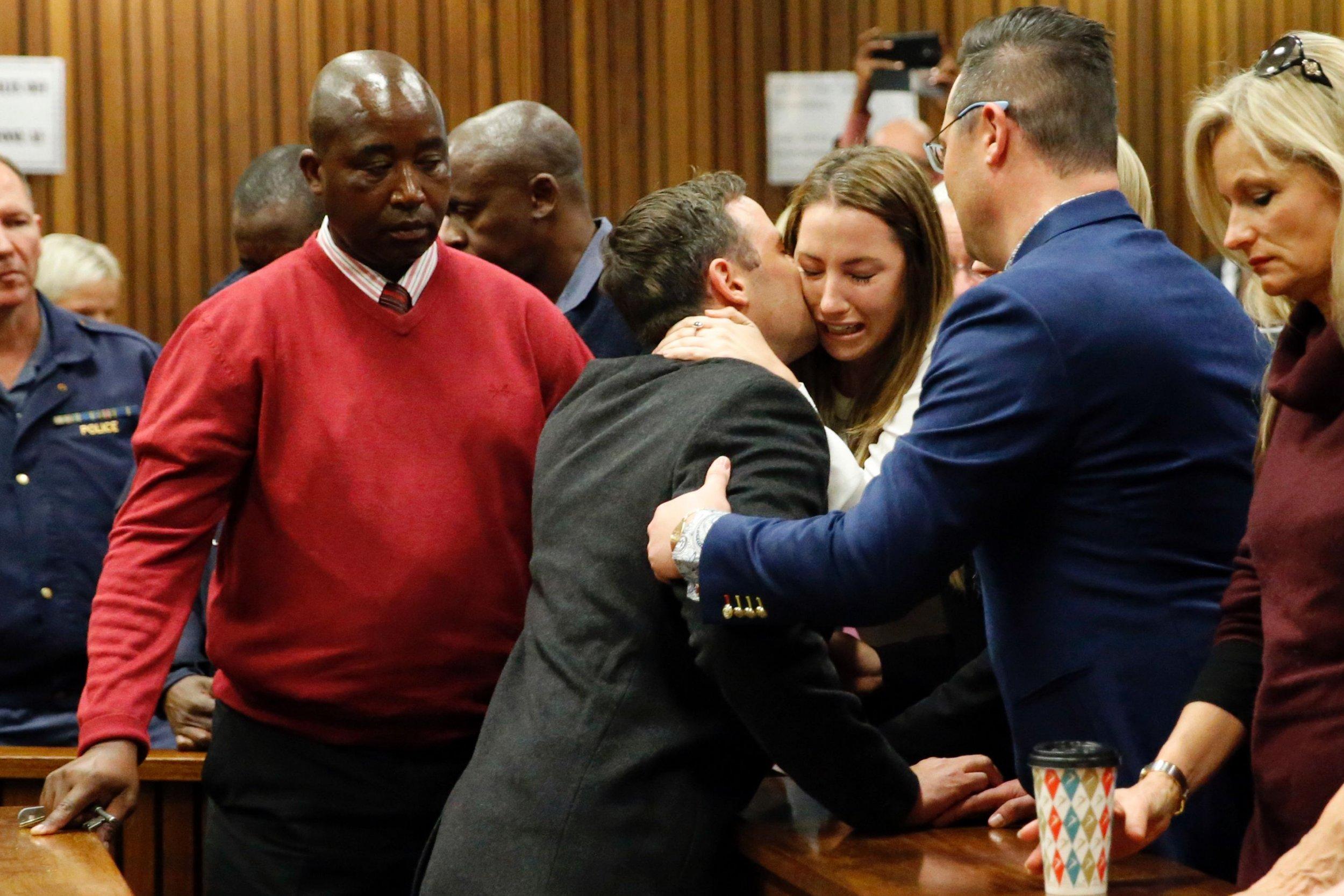 Oscar Pistorius kisses family goodbye as he's jailed for six years for murder of Reeva Steenkamp