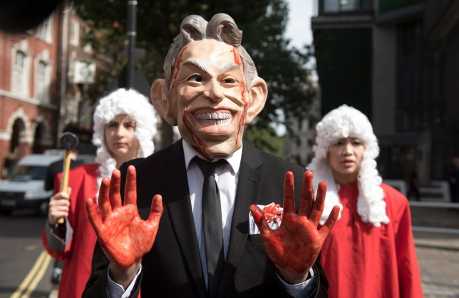 epa05410023 Protesters dressed as former British prime minister Tony Blair (C) hold a demonstration outside the Queen Elizabeth II Conference Centre as they wait for the release of the Chilcot Inquiry in London, Britain, 06 July 2016. The Chilcot Inquiry, chaired by Sir John Chilcot, examines the circumstances surrounding the British Governments involvement in the 2003 Iraq War. EPA/WILL OLIVER