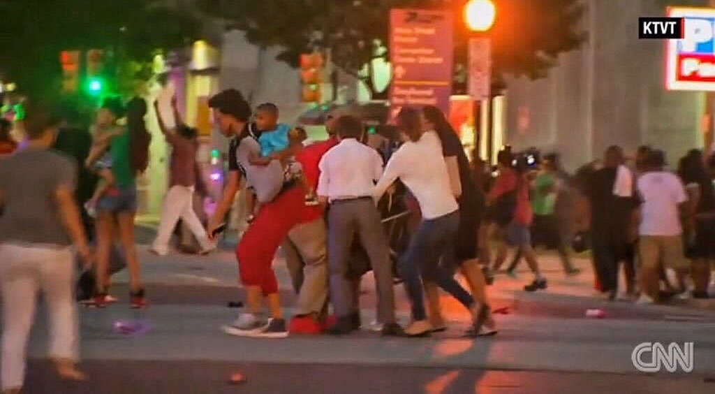 During Dallas shooting these people crowded round a buggy to save baby's life