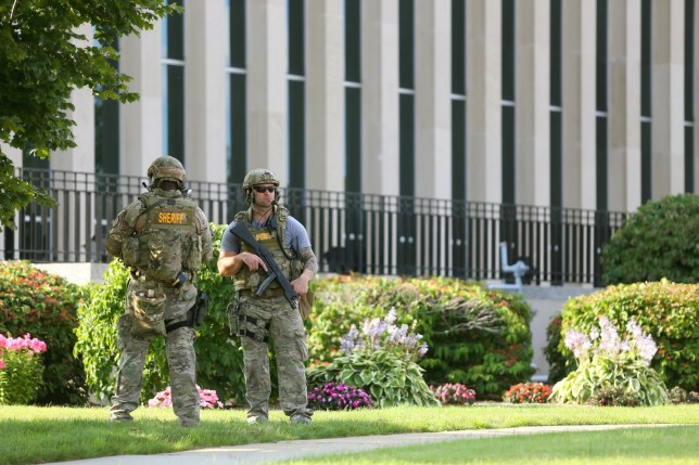 The Berrien County Courthouse is cordoned off as Michigan State Police investigate a crime scene, Monday, July 11, 2016, in St. Joseph, Mich. A jail inmate wrested a gun from an officer and opened fire inside the county courthouse, killing two bailiffs before being shot and killed by other officers. Larry Darnell Gordon, 44, who was locked up on several felony charges, was being moved from a cell for a courtroom appearance when a fight occurred and he was able to disarm an officer, Sheriff Paul Bailey said. (Mark Bugnaski/Kalamazoo Gazette via AP)