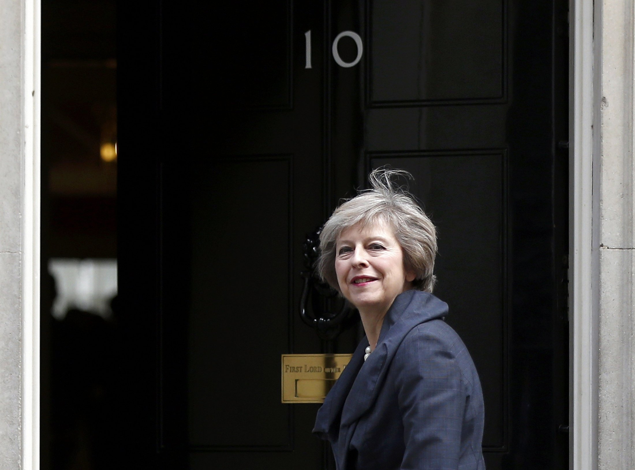 Britain's Home Secretary Theresa May, who is due to take over as prime minister on Wednesday, arrives for a cabinet meeting at number 10 Downing Street, in central London, Britain July 12, 2016. REUTERS/Neil Hall