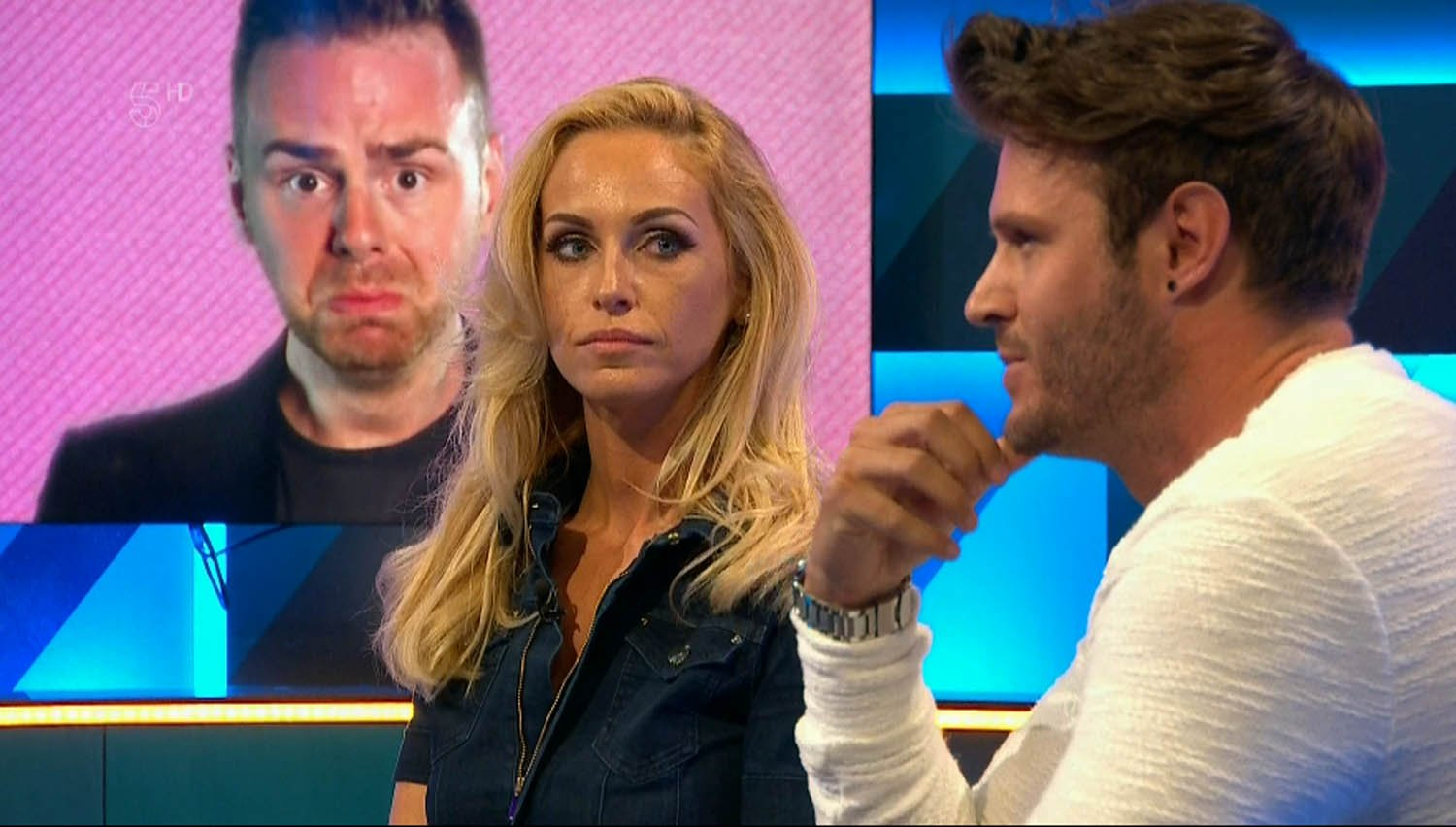"""****Ruckas Videograbs**** (01322) 861777 *IMPORTANT* Please credit Channel 5 for this picture. 13/07/16 Big Brother's Bit On The Side - last night (12th July, 2016), Channel 5 Grabs from last night's BB spin-off show which saw an awkward reunion bwtween Josie Gibson and John James Parton. The former lovers, who met on Big Brother, hadn't seen each for six years and it proved very awkward when John James was introduced onto last night's panel - which Josie was already sitting on. Things didn't get any easier when fellow panelist Jake Quickenden joked that Josie had secretly told him that John James was a """"grower"""" - much to the horror and embarrassment of Josie. Office (UK) : 01322 861777 Mobile (UK) : 07742 164 106 **IMPORTANT - PLEASE READ** The video grabs supplied by Ruckas Pictures always remain the copyright of the programme makers, we provide a service to purely capture and supply the images to the client, securing the copyright of the images will always remain the responsibility of the publisher at all times. Standard terms, conditions & minimum fees apply to our videograbs unless varied by agreement prior to publication."""