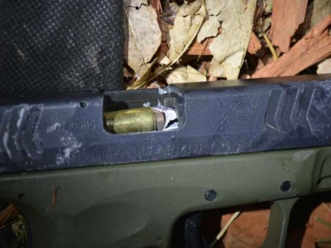 Police officer fires bullet straight down armed robber's gun barrel
