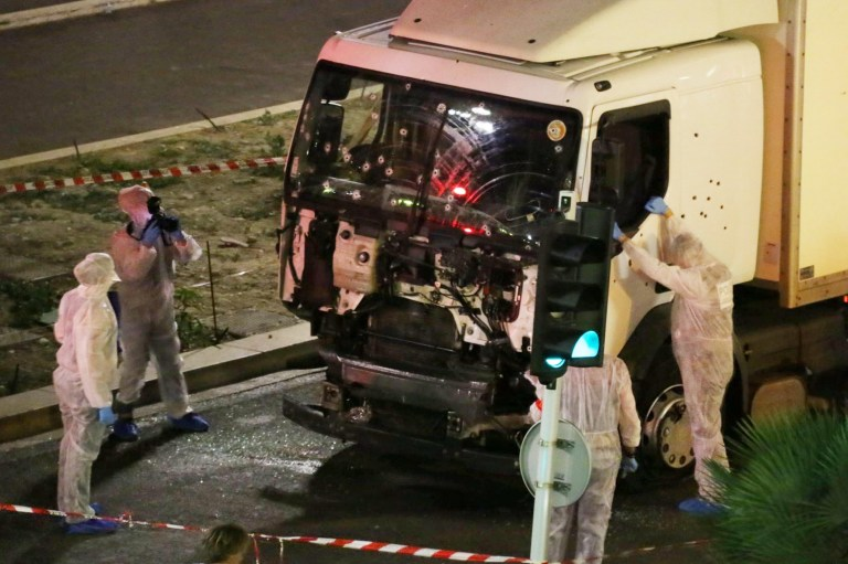 Authorities investigate a truck after it plowed through Bastille Day revelers in the French resort city of Nice, France, Thursday, July 14, 2016. France was ravaged by its third attack in two years when a large white truck mowed through revelers gathered for Bastille Day fireworks in Nice, killing at dozens of people as it bore down on the crowd for more than a mile along the Riviera city's famed seaside promenade. (Sasha Goldsmith via AP)