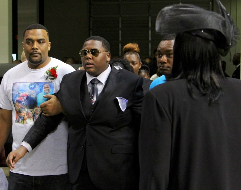 Cameron Sterling, the son of Alton Sterling, enters the funeral of his father in Baton Rouge, Louisiana, U.S. July 15, 2016. REUTERS/Jeffrey Dubinsky