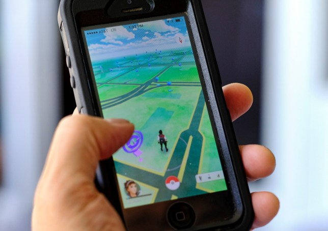 """FILE - In this Friday, July 8, 2016, file photo, """"Pokemon Go"""" is displayed on a cell phone in Los Angeles. Pokemon Goís origins are as peculiar as any of the creatures inhabiting the game. (AP Photo/Richard Vogel, File)"""