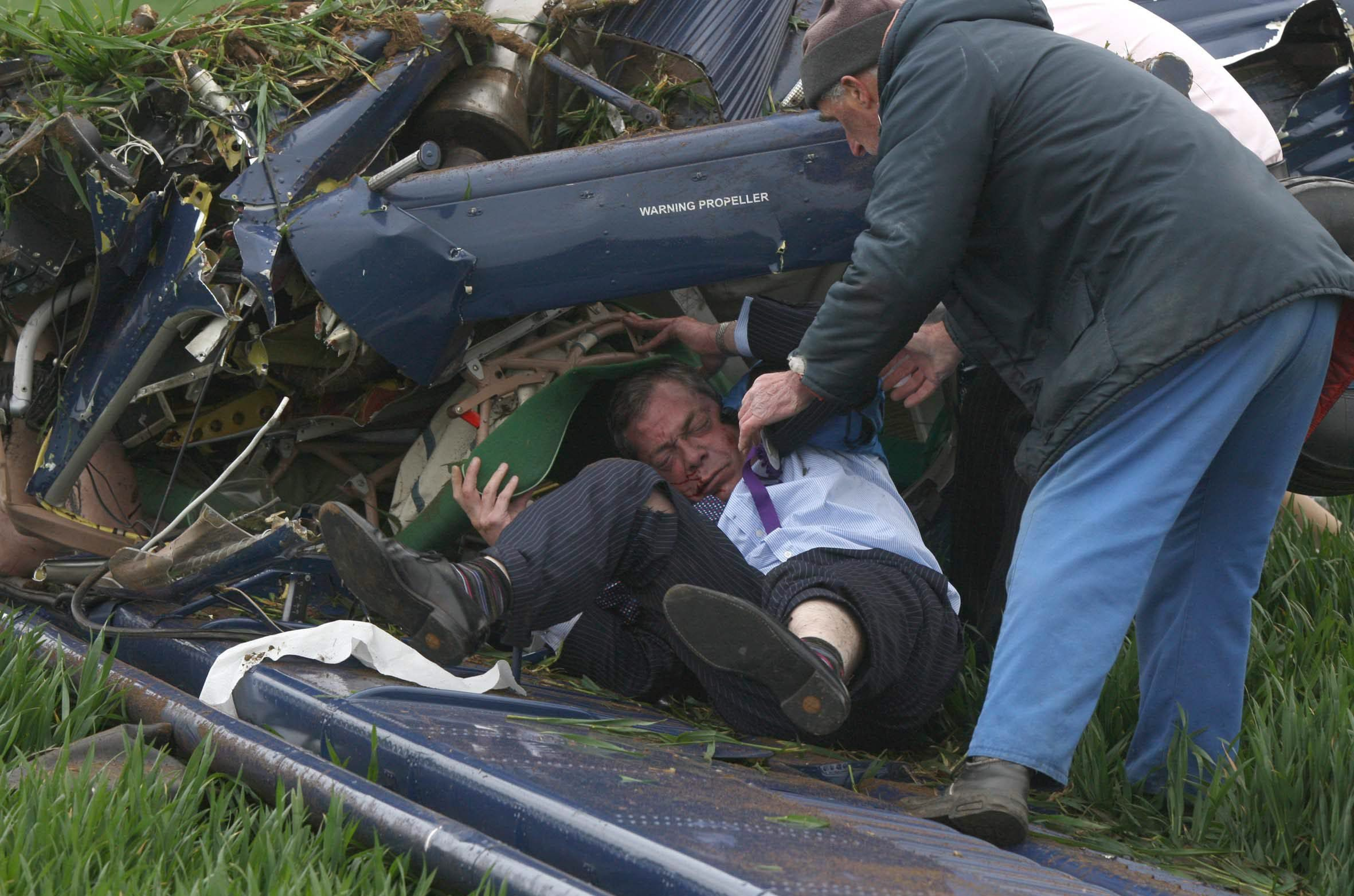 * EXPENSIVE! FEE MUST BE AGREED WITH NEIL HYDE BEFORE USE * UKIP candidate for Buckingham Nigel Farage narrowly escapes death as his plane crashed to the ground at Hinton Airfield, Northamptonshire. Farage was planning on flying a UKIP Banner from the light aircraft when it got caught in the tail causing the crash. Image of Farage being pulled from the wreckage by UKIP PR Man Duncan Barkes and a passerby