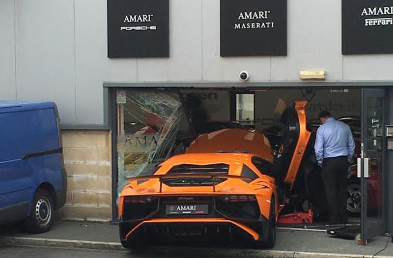 Photographer crashes Lamborghini through showroom window
