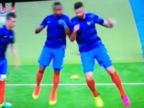 Arsenal star Olivier Giroud floors Manchester United legend Patrice Evra during France warm-up